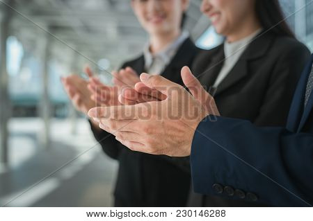 Businessman And Business Woman Clap Their Hands To Congratulate The Signing Of An Agreement Or Contr