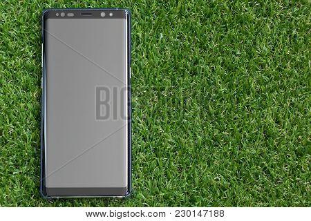 Bangkok, Thailand - December 23, 2017 : Samsung Galaxy Note 8 On Artificial Green Grass Background.
