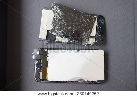 Broken Smartphone On Black Box Preparing For Recycling And Disposal