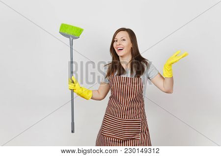 Young Smiling Housewife In Striped Apron Yellow Gloves Isolated On White Background. Housekeeper Wom