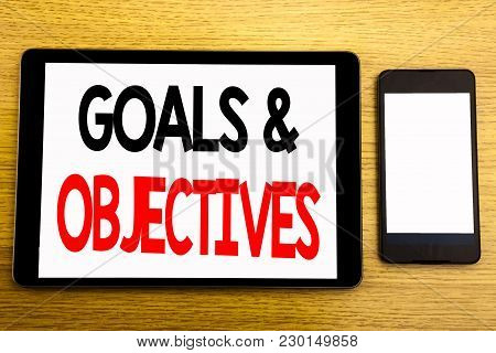Writing Text Showing Goals Objectives. Business Concept For Plan Success Vision Written On Tablet, W