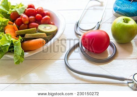 Diet And Weight Loss For Healthy Care With Medical Stethoscope, Fitness Equipment, Vegetable Salad A