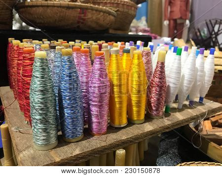 Row Of Multi Color Silk Thread Spools For Sewing Or Crafts