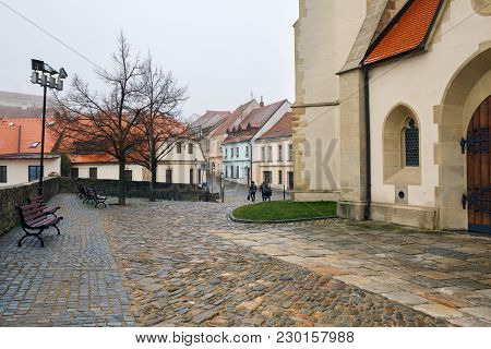 Cobbled Square With The Deanery Church Of St. Nicholas In The Historical Centre Of Znojmo, Czech Rep