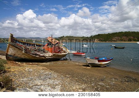 Fishing Boat Wrecked Into A Rocky Shore