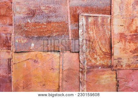 Scratched Orange Rusty Metal Panels. Texture Background