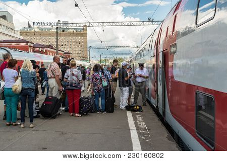 Moscow, Russia - July 11. 2016. Boarding In A Double-decker Fast Train Number 46