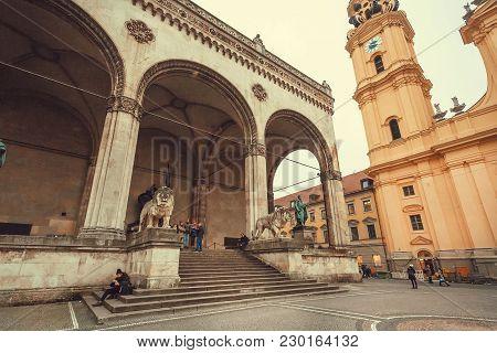 Munich, Germany - November 16, 2017: Busy Square Odeonsplatz With Historical Loggia Feldherrnhalle A