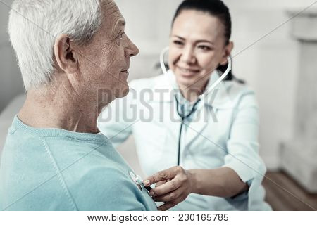 Just Breathe. Senior Pleasant Aged Man Sitting At Home In The Room Having Reception At The Doctor An