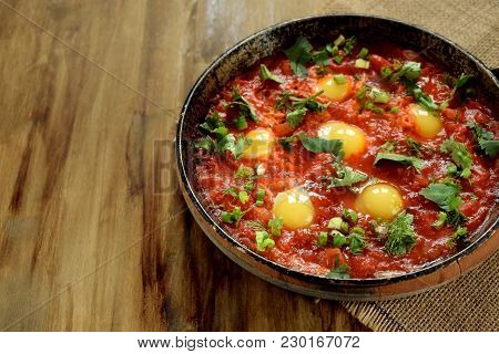Fried Eggs With Tomato Sauce In A Cast Iron Pan. Shakshuka A Traditional Meal Of The Jewish Cuisine.