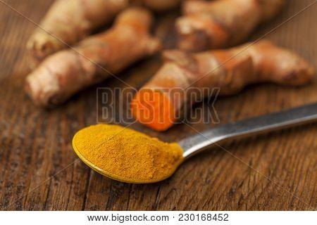 Ground Tumeric On A Spoon On Wood