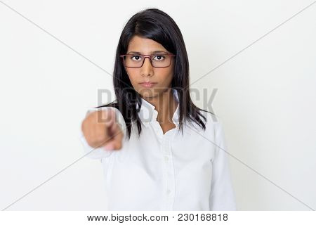Closeup Portrait Of Serious Young Beautiful Indian Woman Looking At Camera And Pointing At Viewer. C