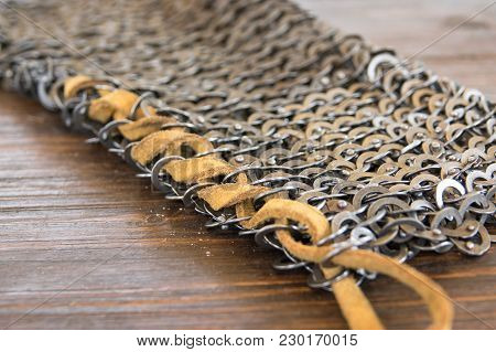 Flexible Leather Seam, To Join The Chainmail Of The Medieval Armor. With Flat Rings That Make Chain
