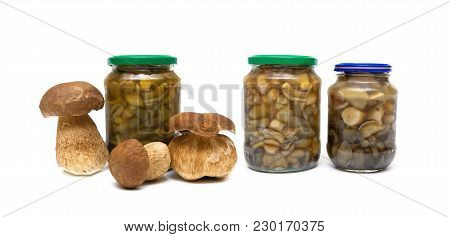 Marinated Mushrooms In The Glass Jars On White Background. Horizontal Photo.