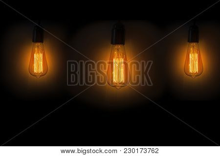 Old Vintage Edison Bulbs In The Dark