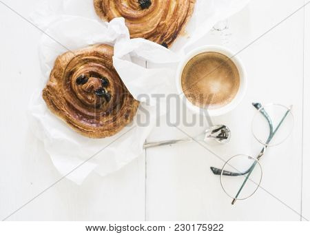 Two Breadrolls And A Cup Of Coffee On A Wooden Background. Clean And White Breakfast Flatlay
