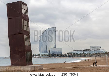 Barcelona,spain-january 15,2016: Barceloneta Beach With Sculpture L Estel Ferit (the Wounded Shootin
