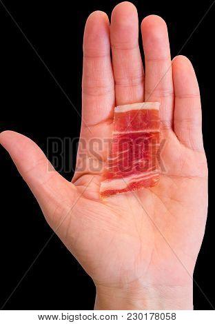 Top View Of Serrano Ham Slice Over Woman Hand