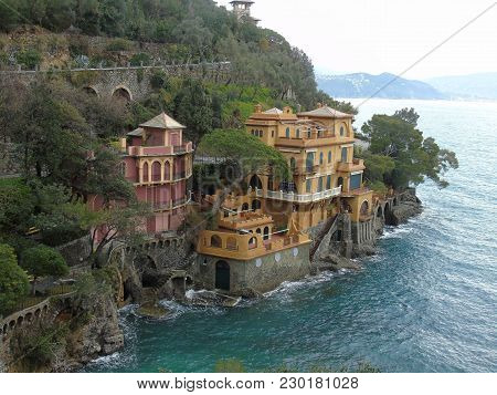 An Amazing Photography Of Portofino With A Grey Sky, Some Boats And The Beautiful Coloured Buildings