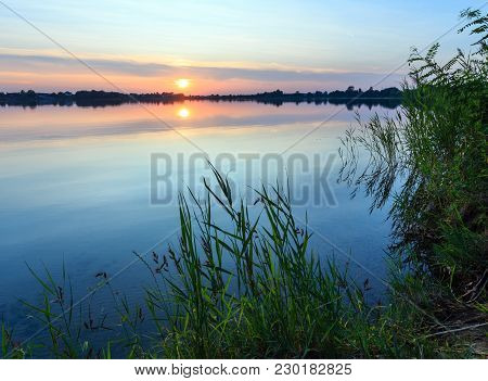 Picturesque Summer Evening Sunset Lake Calm Shore. Concept Of Tranquil Country Life, Eco Friendly To