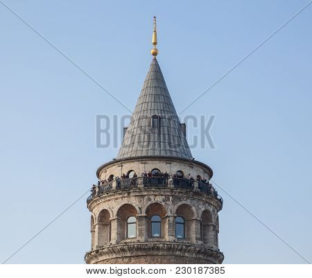 Galata Tower With Tourists Against Blue Sky