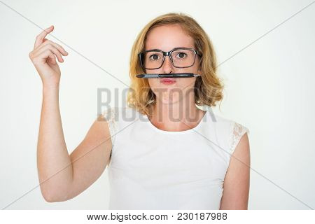 Funny Woman With Pen Moustache. Female Student Snapping Fingers. Playful Mood Concept