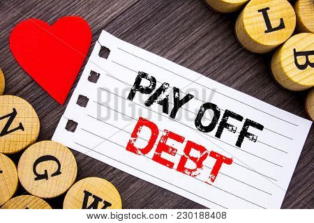 Handwriting Text Showing Pay Off Debt. Conceptual Photo Reminder To Paying Owed Financial Credit Loa