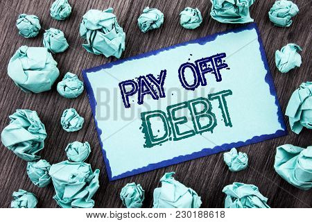 Conceptual Hand Writing Text Showing Pay Off Debt. Concept Meaning Reminder To Paying Owed Financial