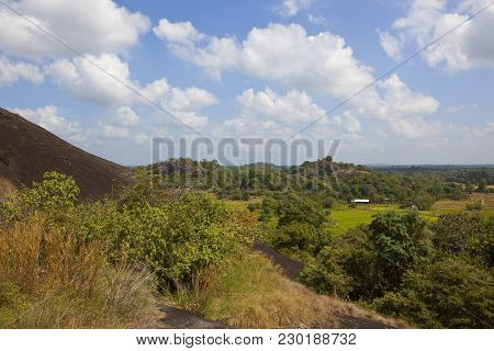 Sri Lankan Volcanic Rock In Beautiful Rural Scenery At Wasgamuwa National Park Under A Blue Sky With