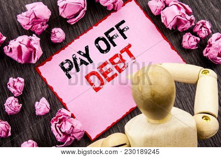 Conceptual Hand Text Showing Pay Off Debt. Concept Meaning Reminder To Paying Owed Financial Credit