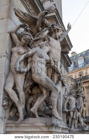 Architectural details of Opera National de Paris: Dance Facade sculpture by Carpeaux. Grand Opera (Garnier Palace) is famous neo-baroque building in Paris, France - UNESCO World Heritage Site.