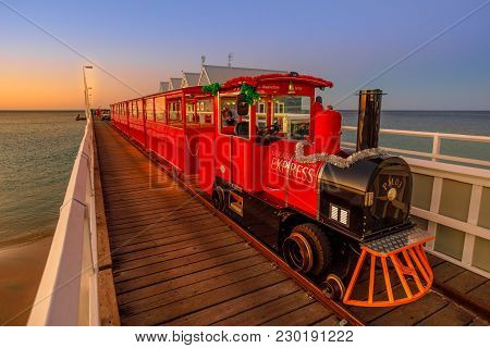Busselton, Australia - Dec 30, 2017: Busselton Jetty Train On The Longest Wooden Pier Tracks In The