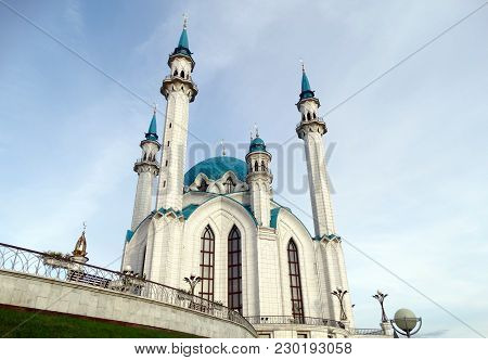 Muslim Mosque On Blue Sky Background. Beautiful White Mosque With Blue Roof Against The Sky With Clo