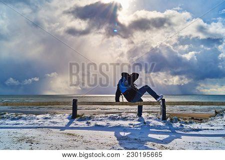 Bannow County Wexford Ireland In February 28 2018; Backpacker Adventural Enjoying Sunny Snow Beach V