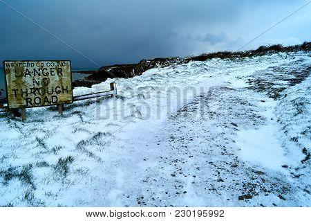 Winter Icy Road Along Cliffs Under Snow In Wexford Ireland.