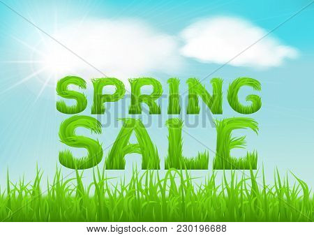 Spring Sale Inscription Made Of Grass. Spring Background With Green Early Spring Grass On Blurred So