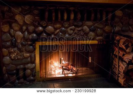 Wood Burning In A Fireplace For Warmth At A Wedding Reception In California.