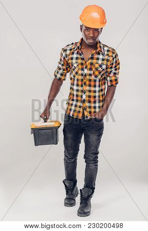 African American Construction Worker In Helmet With Yellow Plastic Tool Box