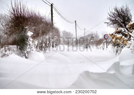Bannow County Wexford Ireland In March 2 2018; Extreme Weather Snowdrift On The Road.