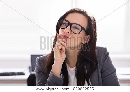 Close-up Of A Young Contemplated Businesswoman Wearing Spectacles