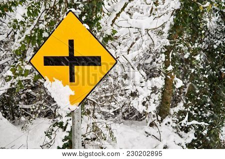 Irish Crossroad Sign Covered In Snow With Winter Snow Background Theme.