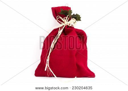 Cute Red Sack Present With Ribbon On A White Background
