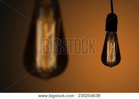 Vintage Hanging Edison Lights Bulbs Over Dark Background