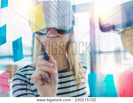 Smart Woman. Clever Positive Young Woman Wearing Modern Convenient Virtual Reality Glasses And Smili