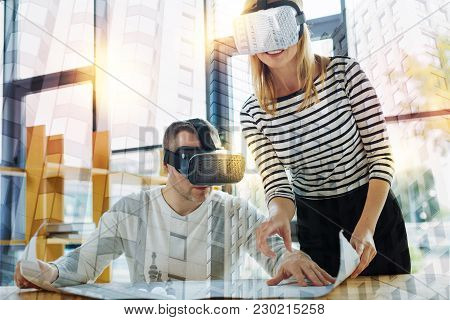 Detailed Graphic. Clever Experienced Creative Designers Wearing Modern Virtual Reality Glasses And F