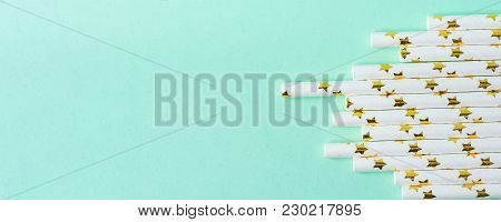 Elegant White Paper Drinking Straws With Golden Stars Pattern Scattered On Turquoise Background. Low