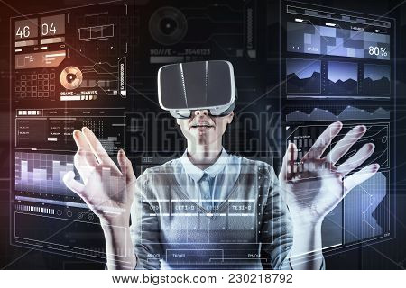 Impressive Device. Clever Professional Young Programmer Standing In Her Modern Futuristic Office And