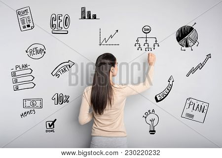 Success. Smart Experienced Enthusiastic Employer Looking Concentrated While Drawing On The Board And