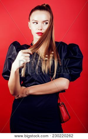 Young Pretty Woman Young Lady Posing On Red Background, Lifestyle People Concept Close Up
