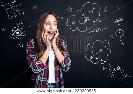 Unbelievable. Smart Emotional Young Woman Feeling Excited And Touching Her Face With Two Hands While